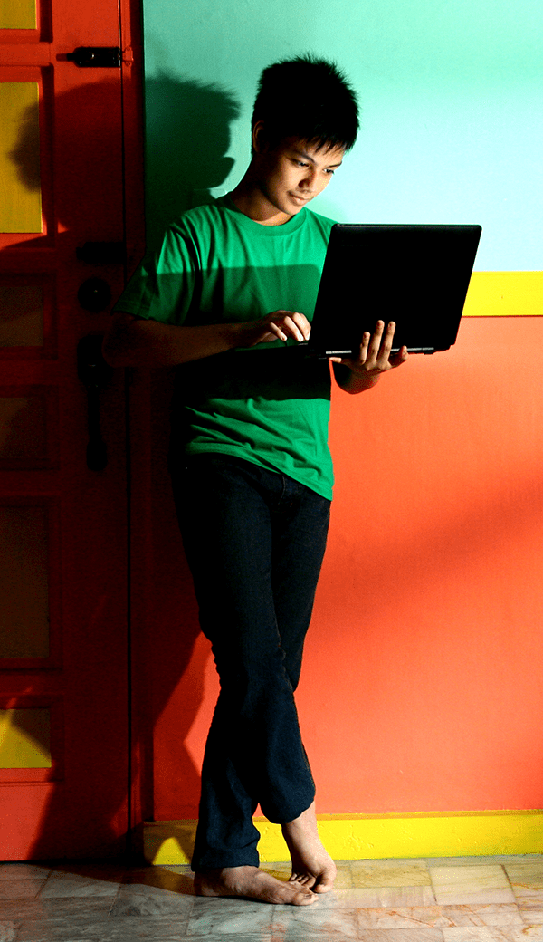 standing child with laptop