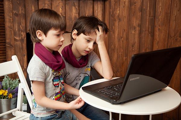 young boys at computer